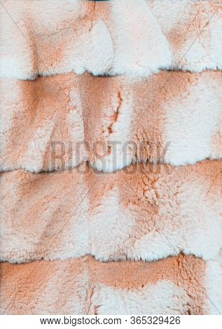 Fluffy Abstract Background. Faux Fur Texture. Peach Pink White Hairy Cloth Surface.