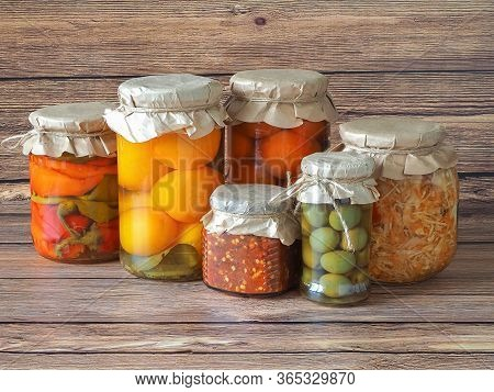 Marinated Pickles Variety Preserving Jars On The Kitchen Wooden Table. Fermented Homemade Food.