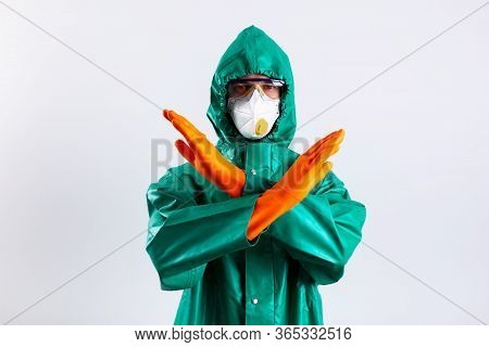 Man In Hazmat Suit Demonstrating Prohibition Against The White Background