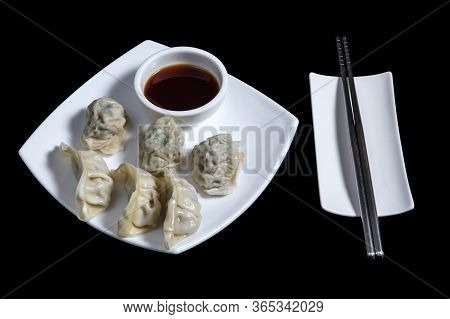 Oriental Dim Sum, Gyoza, Dim Sum Or Jiaozi Isolated On Black
