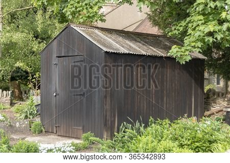 A Close Up View Of A Outside Wooden Shed In The Back Garden