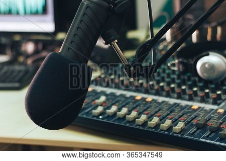 Radio Host Microphone, Mixing Console And Headphones Close-up