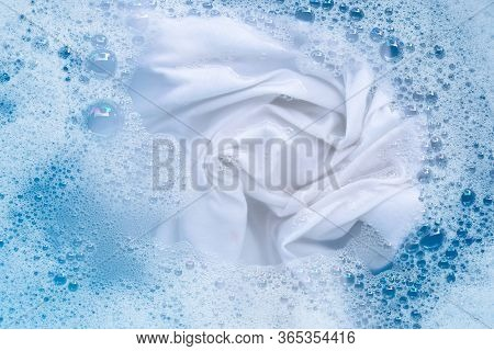 Top View Of Soak A Cloth Before Washing, White Cloth