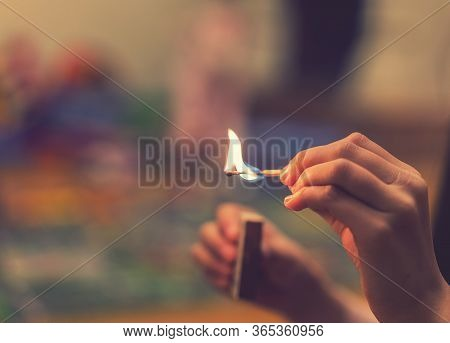 The Child Lighting The Matches. The Fire In The Hands Of A Child. A Small Child Plays With Matches,