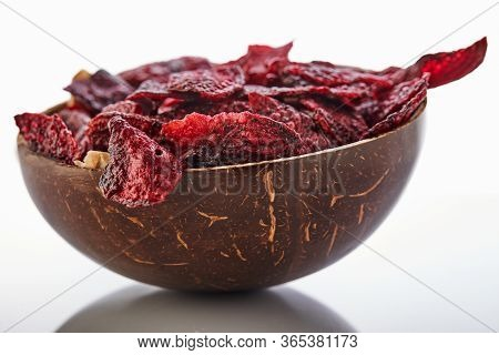 Diet Healthy Eating Concept. Dried Beet Chips Or Baked Beets In A Bowl Isolated On A White Backgroun