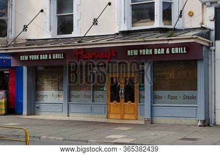 Llandudno, Uk : May 6, 2019: The Llandudno Branch Of Harvey's New York Bar And Grill Is Located On M