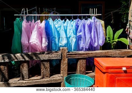 Someone Selling Safety Vests And Raincoat At Local Market. Thailands Traditional Street Store. Rain