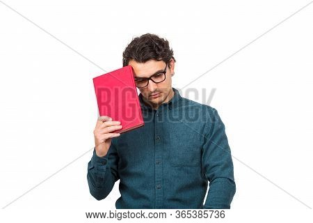Pessimistic Student Guy Looking Down Upset, As Holds A Book Isolated On White Background. Confused Y