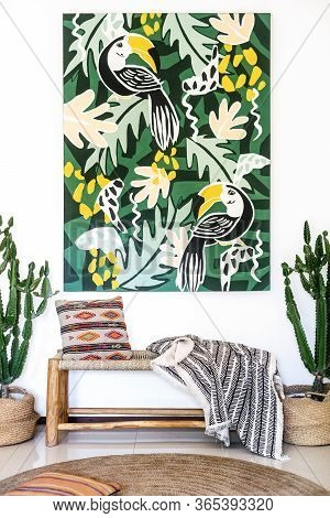 Vertical Photo Of Room With Cozy Interior Design, Artwork Painting On Wall, Bench Seat, Cushions, Pl