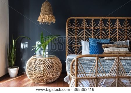 Stylish Bedroom Interior At Modern House With Ethnic Decor, Lamp Over Bedside Table, Comfortable Wic