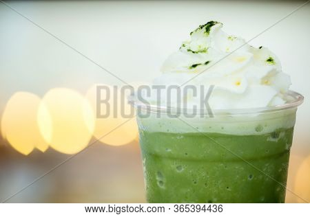 Close Up Green Tea Frappe With Light Bokeh Background, Soft And Blur Style For Background, Wallpaper