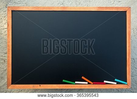 A Color Chalk On Empty Chalk Board Background/blank.blackboard Background.blackboard Texture. Chalkb
