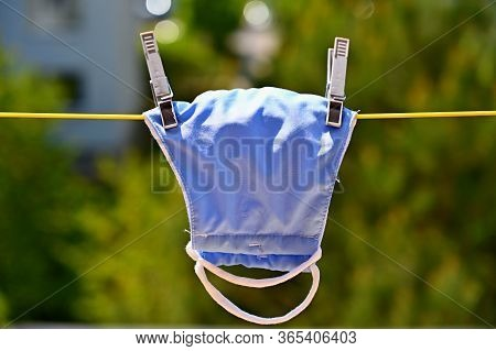 Face Mask On A Clothesline. Washing And Disinfection Against Coronavirus Covid - 19.