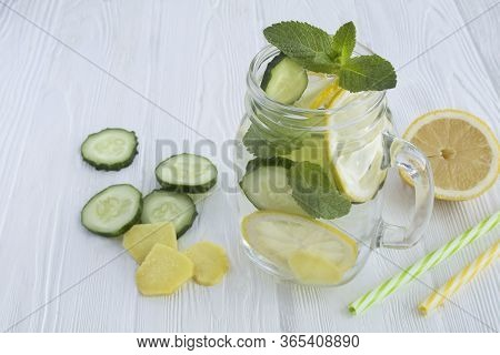 Sassy  Water  Slimming Or Infused Water With Lemon, Cucumber And Ginger In The Glass On The White Wo