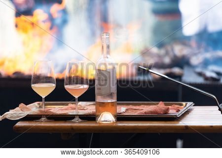 Orange And White Wine In Glasses. Cooking Meat And Drinking Wine. Wine On The Background Of A Large