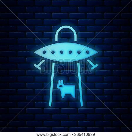 Glowing Neon Ufo Abducts Cow Icon Isolated On Brick Wall Background. Flying Saucer. Alien Space Ship