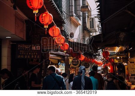 Jiufen, Taiwan - November 07, 2018: People Walk With Purchases Along The Crowded Old Street Market O