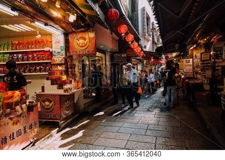 Jiufen, Taiwan - November 07, 2018: People Walk With Purchases Along The Old Street Market On Novemb