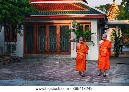 Bangkok, Thailand - February 28, 2018: Thai Monks Walking Near Famous Wat Pho Public Ancient Temple