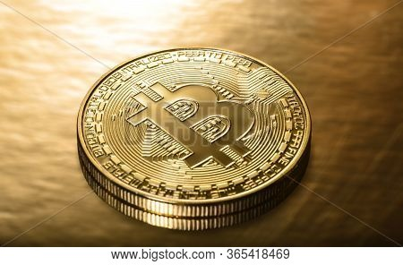 Crypto Currency Golden Bitcoins On A Gold Background. Photo Virtual Money.blockchain Technology, Bit