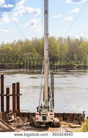 Kirishi, Russia - 8 May, Drilling Rig On The Shore, 8 May, 2020. Start Of Construction Of A Motor Br