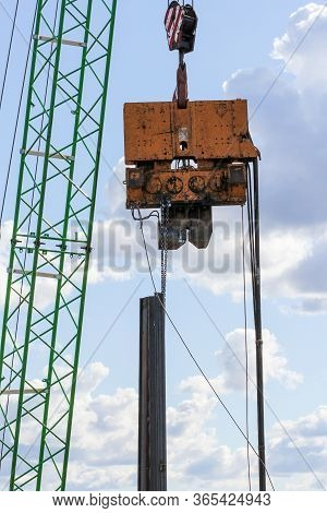 Lifting Heavy Loads With A Crane. Start Of Construction Of A Motor Bridge Over The Volkhov River.