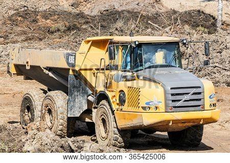 Kirishi, Russia - 8 May, Heavy Dump Truck On Earthwork, 8 May, 2020. Start Of Construction Of A Moto