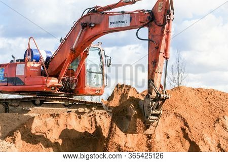 Kirishi, Russia - 8 May, An Excavator Works On A Pile Of Sand, 8 May, 2020. Start Of Construction Of