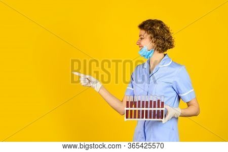 Medical Worker Testing Tubes Vaccination. Blood Samples. Medical Professional Developing Vaccine. Co