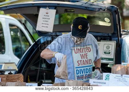 Davis, California, Usa. May 9, 2020. Caucasian Senior Male Selling Mushrooms In The Farmers Market W