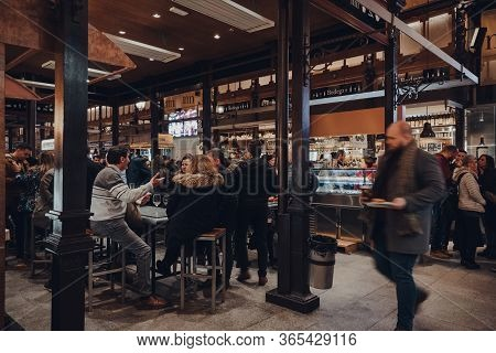 Madrid, Spain - January 26, 2020: People At The Tables Inside Mercado De San Miguel (
