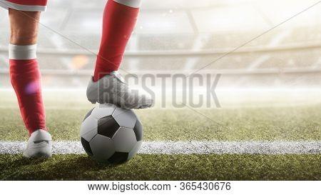 Soccer Closeup. Leg Of Soccer Player On The Ball. Soccer Background.