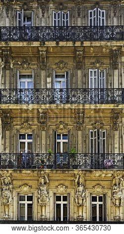 16 Aug 2018. Facade Of Antique Buiding With Wooden Windows.
