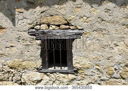 Antique Wooden Rusty Metal Window On Stone Wall