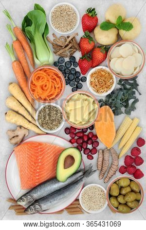 Healthy food and herbs for irritable bowel syndrome. Health foods high in antioxidants, protein, omega 3, dietary fiber, vitamins, minerals, smart carbs & anthocyanins. Flat lay.