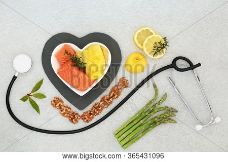 Healthy heart food for low cholesterol with seafood, fruit, vegetables, nuts & stethoscope. Foods high in fibre, antioxidants, vitamins, omega 3 &  protein. Support for the cardiovascular system.