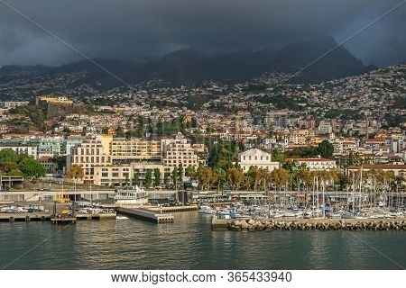 Funchal, Portugal -  November 10, 2019: Funchal Bay With Marina And The Street Avenida Do Mar With T