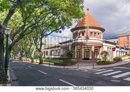 Funchal, Portugal -  November 10, 2019:  Lined With Subtropical Trees Street Rua Joao De Deus With T