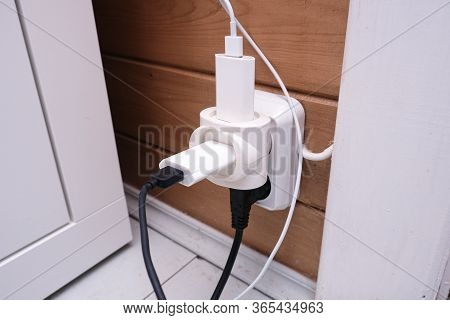 Overloaded Outlet With An Extension And Many Sockets Plugged In, Risk Of Fire And Short Circuit In A