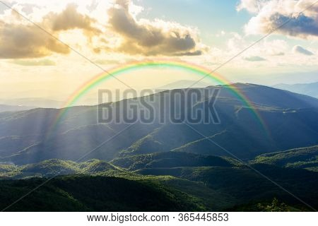 Wonderful Alpine Landscape On Summer Evening. Rolling Hills Of Great Mountain Range In Warm Light Be