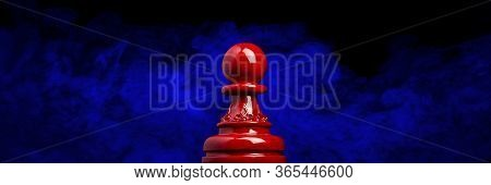 Macro Image Of A Wooden Chess Pawn In Red With Blue And Smokey Black Background