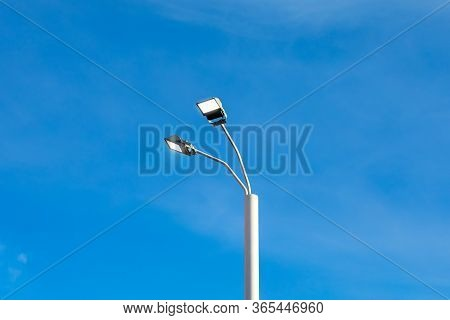 Modern Street Led Lighting Pole On Blue Sky Background. Urban Electric Power Technologies. Saving On