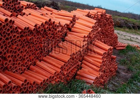 Ceramic Drainage Pipes Of Red Color For The External Sewerage. Traditional Material, Inside The Shap