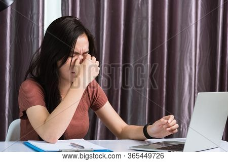 Work From Home, Fatigued Or Strain Asian Business Young Beautiful Woman Sits On Desk Workspace Feeli