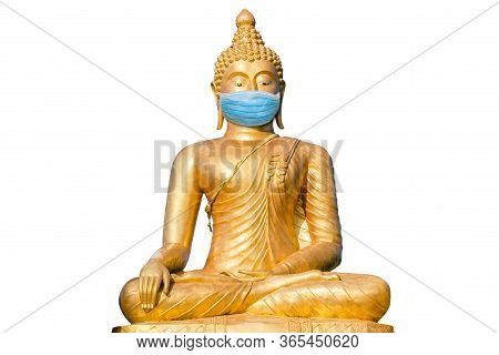 Golden Buddha With Surgical Mask Isolated On White Background. Buddhism And Meditation At Time Of Co