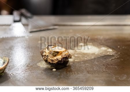 Grilled Shellfish Or Seafood Food On Hot Plate Pan During Teppanyaki Japanese Chef Cooking And Grill