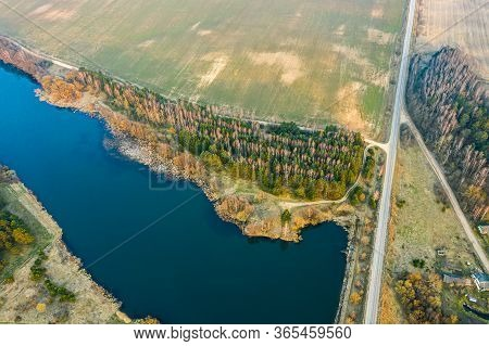 Rural Landscape With Blue Lake, Green Fields And Country Road. Spring Belarusian Nature