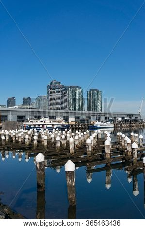 Melbourne Docklands Cityscape With Wharf, Boats And Modern Buildings