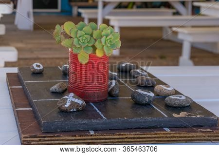 Tic Tac Toe Game. Wooden Board With Stones Painted With 0 And X For Tic Tac Toe Game