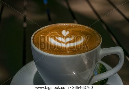 Freshly Brewed Coffee With Milk Froth Art. Coffee In A White Cup On A Wooden Table. Morning Coffee D